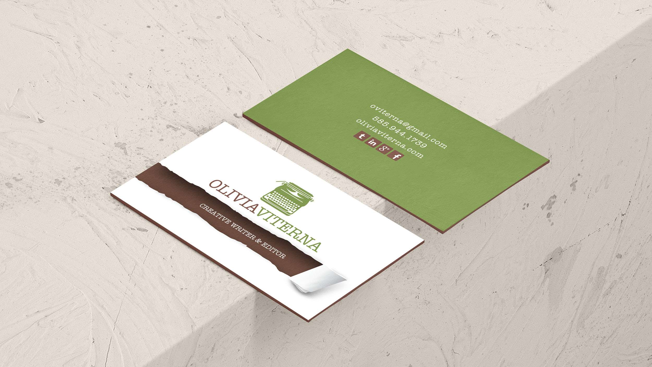 Custom business card design using wripped paper tear and green typewriter.