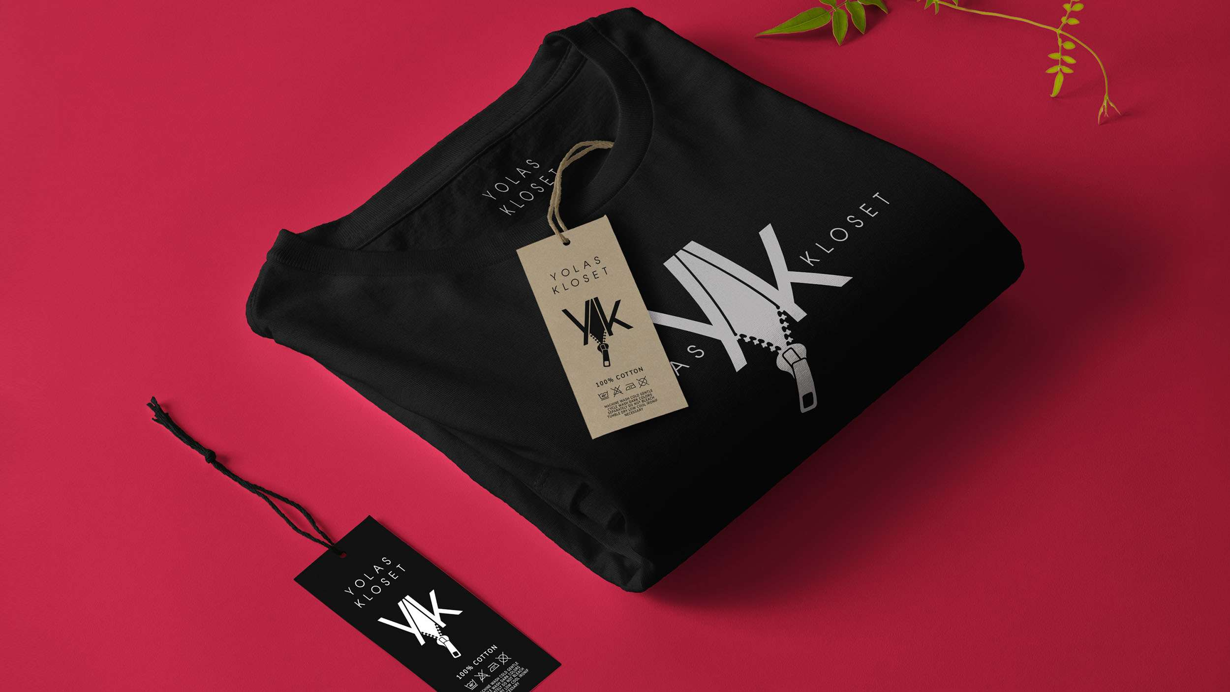Clothing brand graphics on black t-shirt for Yolas Kloset.