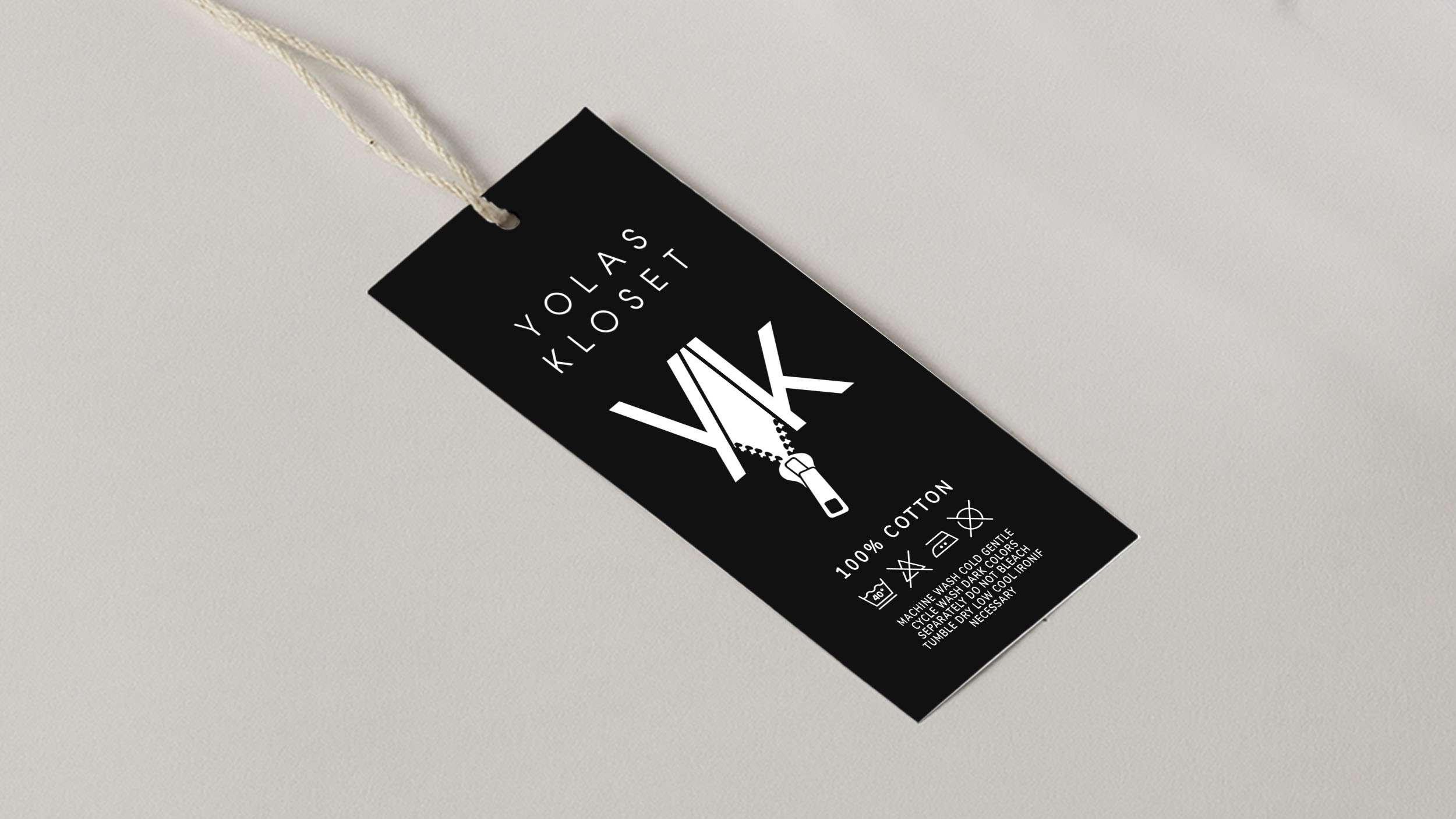 Custom t-shirt tag design for clothing brand, using black and white color palette.