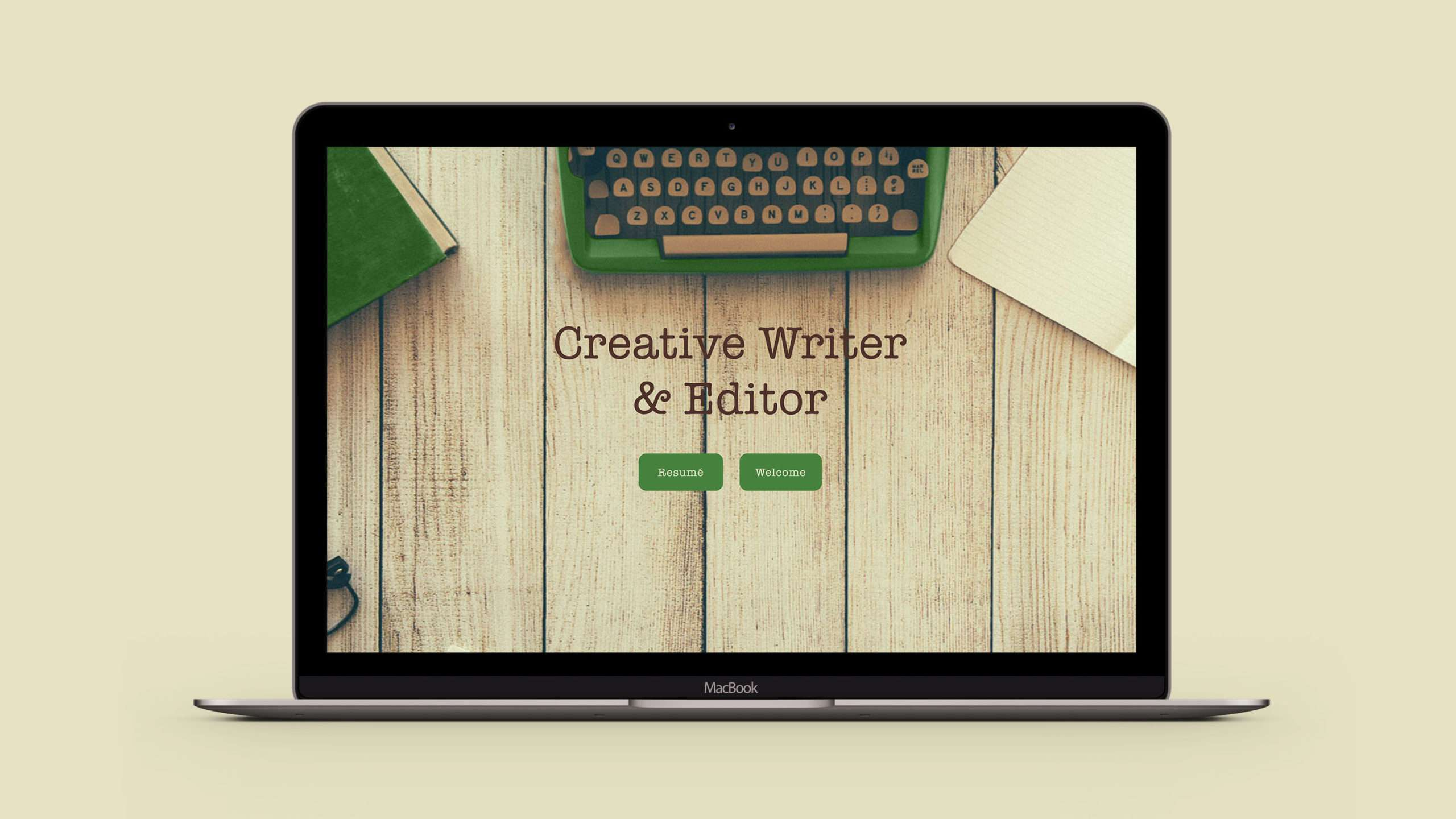 Custom web design for creative writer & editor, using a green typewriter and wood textured background.